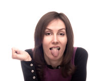 Woman showing tongue out isolated white Royalty Free Stock Image
