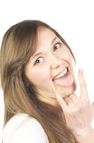 Woman showing tongue and sign of the horns gesture Royalty Free Stock Photography