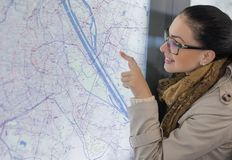 Woman showing or touching  the town plan Royalty Free Stock Photos