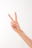 Woman showing two fingers Stock Photo