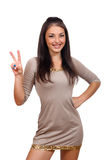 Woman showing two fingers or victory gesture. Happy smiling beautiful young woman showing two fingers or victory gesture Stock Photos