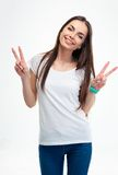 Woman showing two fingers or victory gesture Royalty Free Stock Photography