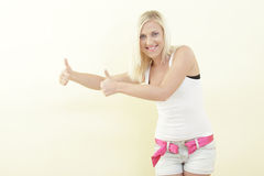 Woman showing two thumbs up Stock Photography