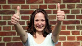 Woman showing two thumbs up stock video