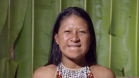 Woman showing the upper teeth. Like in front of the dentist in Ecuador stock video footage