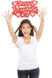 Woman showing Valentines day sign Stock Image