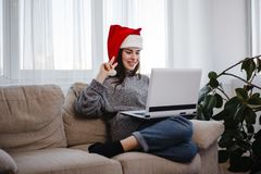 Woman showing victory gesture during video call stock photos