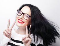 Woman showing victory or peace sign Stock Photos