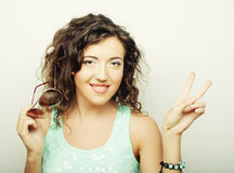 Woman showing victory or peace sign Royalty Free Stock Photo