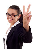 Woman showing victory sign Stock Photography