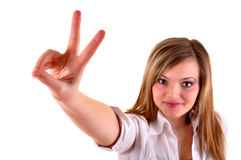 Woman showing victory sign Stock Images