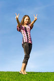 Woman showing victory sign Royalty Free Stock Image