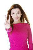Woman showing victory sign Stock Photo