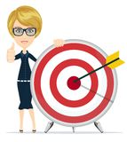 Woman showing victory sign, holding a target with Royalty Free Stock Photography
