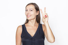 Woman showing the victory symbol Royalty Free Stock Photography