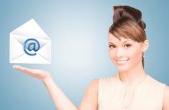 Woman showing virtual envelope Royalty Free Stock Image