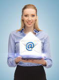 Woman showing virtual envelope Royalty Free Stock Photos