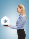 Woman showing virtual envelope Royalty Free Stock Photography