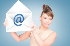 Woman showing virtual envelope Stock Images