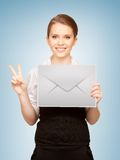Woman showing virtual envelope Royalty Free Stock Photography