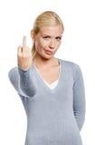 Woman showing vulgar gesture Royalty Free Stock Image