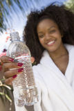 Woman Showing Water Bottle Royalty Free Stock Photos
