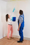 Woman Showing Water Leaking From Ceiling To Maintenance Guy Stock Photos