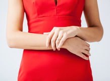 Woman showing wedding ring on her hand Stock Photos