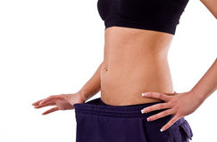 Woman showing weight loss Royalty Free Stock Images