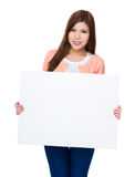 Woman showing the white banner Stock Photos