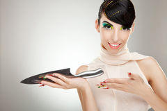 Woman showing you a big kitchen knife Royalty Free Stock Photos