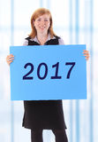 Woman showing 2017 Royalty Free Stock Photo
