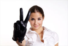 Woman shows. Pretty woman with long hair and black leather glove Stock Photo