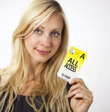 Woman shows Access card. Young Business woman is smiling while showing her security pass Royalty Free Stock Image