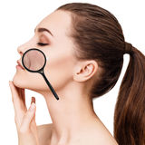 Woman shows age-related mimic wrincles. Woman with magnifying glass shows age-related mimic wrincles on her face Stock Photography