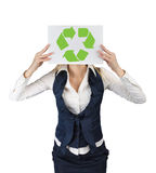 A woman shows a banner with the symbol of recycling Stock Image