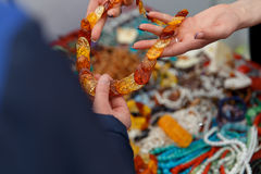 Woman shows beads on the market. royalty free stock image