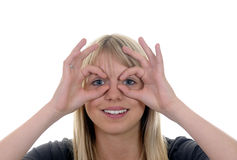 Woman shows binoculars Royalty Free Stock Photography
