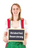Woman shows blackboard : Oktoberfest reservation Royalty Free Stock Photos