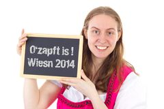 Woman shows board : O zapft is ! Wiesn 2014 Stock Photo