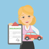 Woman shows car insurance. Stock Image