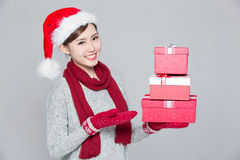 Woman shows a christmas gift Stock Photo
