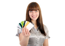 Woman shows credit and discount cards Stock Image