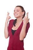 Woman shows crossed fingers Stock Image