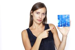 Woman shows with finger on a solar cell Stock Photography