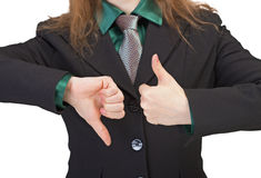 Woman shows gestures - thumbs up and downw Stock Photo