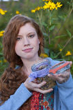 Woman shows a glass of herbs Royalty Free Stock Photography