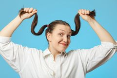 Woman shows hair Stock Images