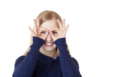 Woman shows with hands  binoculars Royalty Free Stock Images