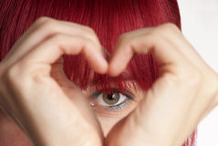 Woman shows heart. Detail of a formed hand with heart and eye Royalty Free Stock Image